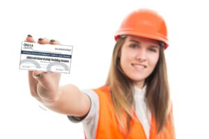 Woman Construction Worker with OSHA 30hr Safety Card